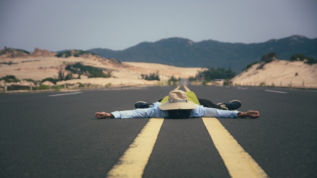man lying in road